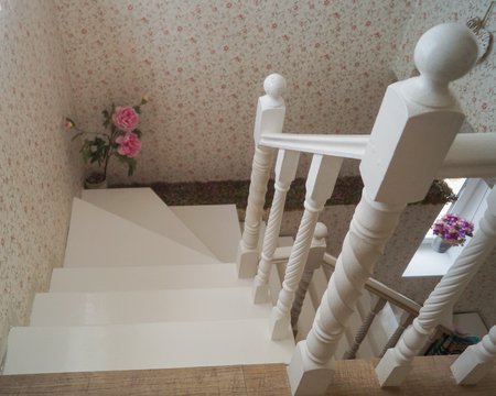 staircase of white marble with decorative elements in soft natural light, selective focus