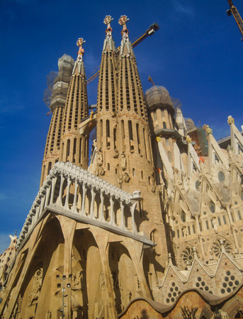 BARCELONA, SPAIN - January 9: Sagrada Familia on January 9, 2018 in Barcelona, Spain. This impressive cathedral was originally designed by Antoni Gaudi is still being built since 1882.