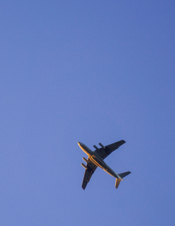 the plane is flying in a clear blue sky diagonally