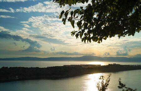 A beautiful Croatian coastal sunset overlooking the Adriatic Sea. Sunset horizon sea water landscape.