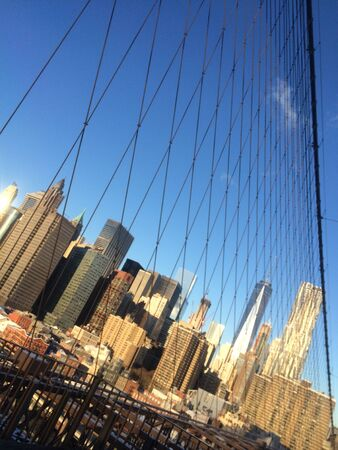 Amazing view at the New York City Brooklyn Bridge in Manhattan with skyscrapers and city skyline over Hudson River Фото со стока