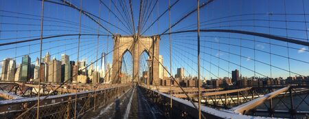 A view of the Brooklyn Bridge in New York City. Фото со стока