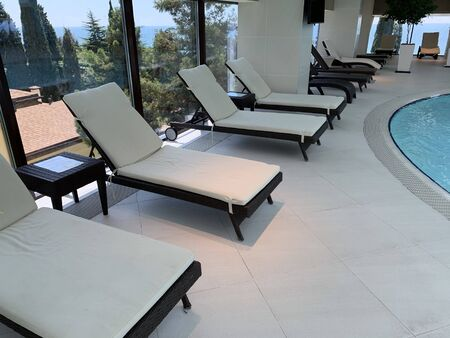 spa hotel interior swimming pool white chairs