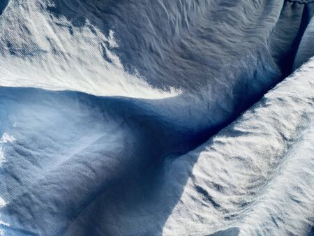 blue grey fabric texture and background, Wavy fabric or crumpled textiles wallpaper. crumpled surface with sunlight