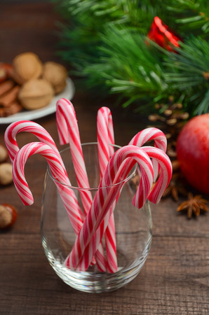 peppermint candy: Peppermint Candy Canes and other Christmas decorations on wooden background