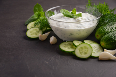 Tzatziki sauce and ingredients, selective focus, copy space