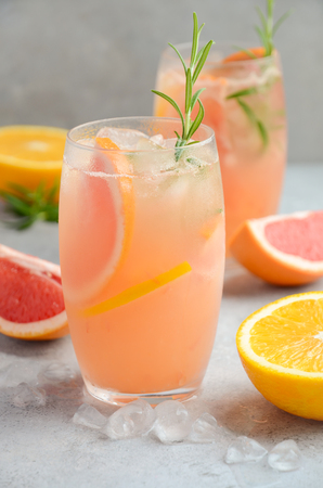 Refreshing citrus cocktail with grapefruit, orange and rosemary