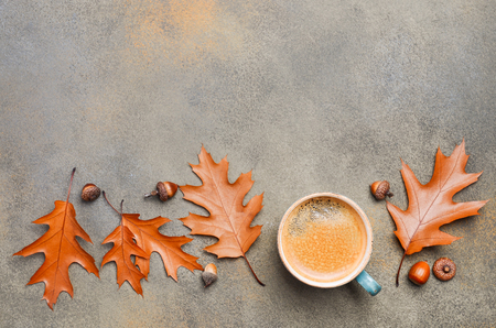 Autumn Composition with Cup of Coffee and Autumn Leaves on Stone or Concrete Background