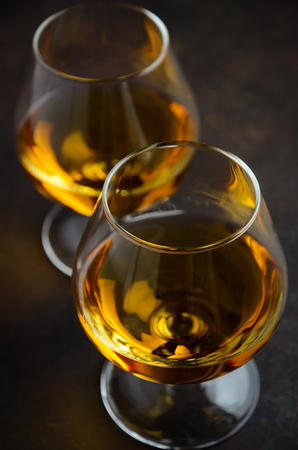 Glass of whiskey with ice on the old rusty background Stock Photo