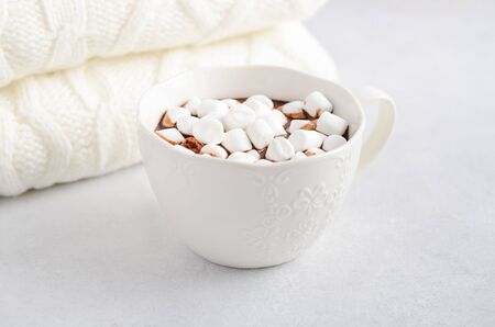 Cup of hot chocolate with marshmallows on a gray concrete background. Stock Photo