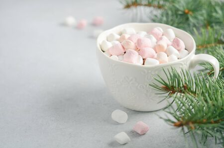 Cup of hot chocolate with marshmallows on a gray concrete background. Christmas concept. Stock Photo