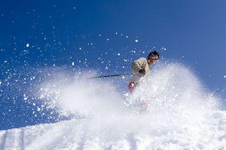 Snow Skier Jumping Against Blue Sky