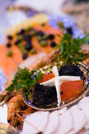 Big plate with red and black caviar, seafood and vegetables at russian restaurant.  photo