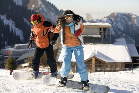 tien shan: A lifestyle image of two young adult  snowboarders, Tien Shan, Asia
