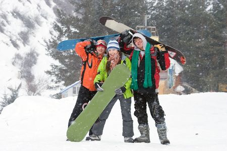 snow break: Healthy lifestyle image of happy snowboarders team,  Snowfall