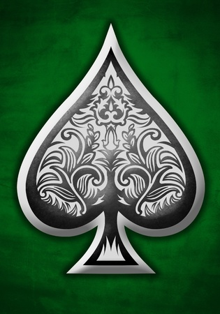 Poker spade on a green background photo