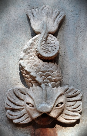 Fish carved on a stone  photo
