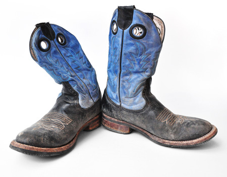 working cowboy: A pair of blue rodeo cowboy boots on a white background