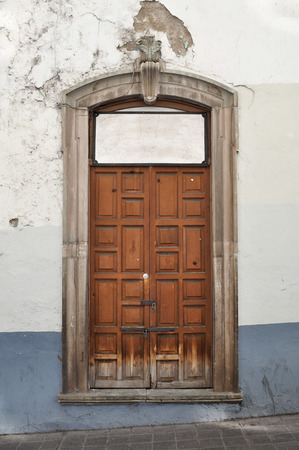 Front of an old mexican house - Colonial style door and window - Guanajuato Mexico  photo