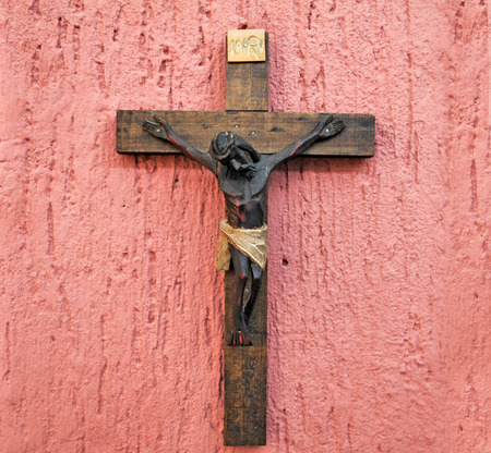 christian confirmation: Wood crucifix on a pink background
