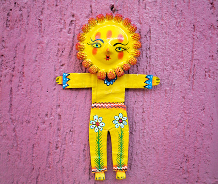 Sunflower figurine on a pink wall in San Miguel de Allende Mexico  photo
