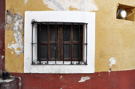 oldened: Old window, Front of an old mexican house - San Miguel de Allende Mexico Stock Photo
