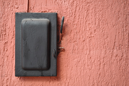 fuse box: Old black switch - lever over red wall