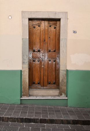 Front of an old mexican house - Colonial style door and window - San Miguel de Allende Mexico photo