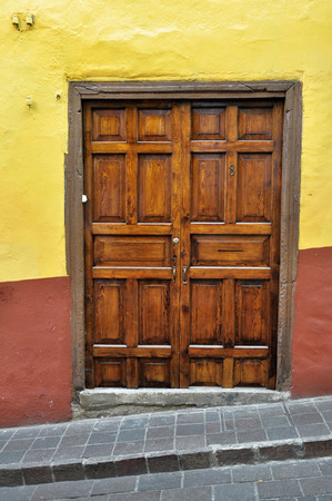 oldened: Front of an old mexican house - Colonial style door - San Miguel de Allende Mexico