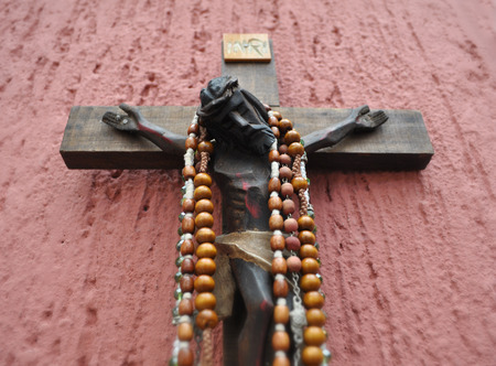 rosary beads: Mexican wooden crucifix with several rosaries  necklaces Stock Photo