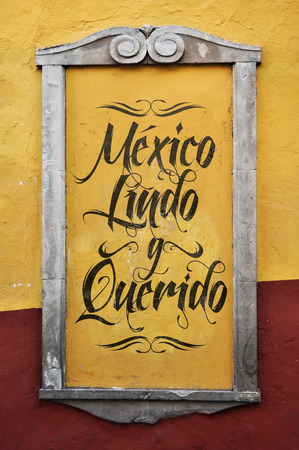 mexico background: Mexico Lindo y Querido - Mexico Beautiful and beloved spanish text, graffiti in a colonial frame - wall Stock Photo