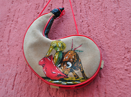 receptacle: Bullfighter bota bag or wineskin, is a traditional Spanish leather liquid receptacle, canteen Stock Photo