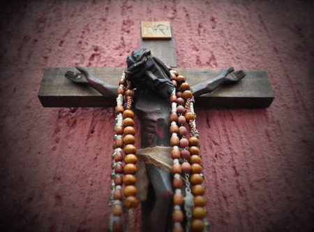 vignette: Mexican wooden crucifix with vignette