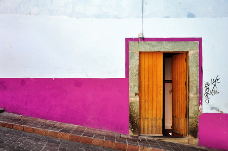 oldened: Pink Mexican house, Colorful building located in Guanajuato Mexico