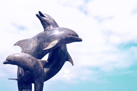 sculpture: Dolphins fountain on Malecon at Pacific ocean in Puerto Vallarta, Mexico.