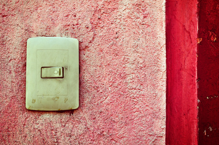 door bell: Plastic light switch box, vintage mexican door bell and red wall