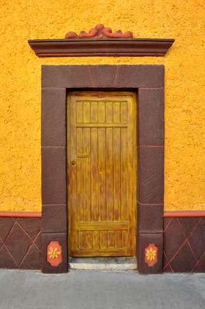 oldened: Mexican colorful colonial style door in Bernal Queretaro Mexico.