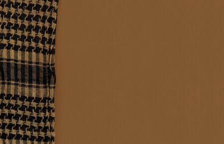 Shemagh Cloth on tan color surface background. 版權商用圖片 - 128924634