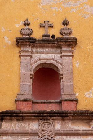 Colonial Cornice and Cross, old Church in San Miguel Mexico.