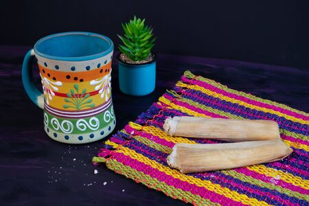 Tamales Mexican dish made of Corn dough and Coffee Jar on Woven Tablecloth. Stok Fotoğraf