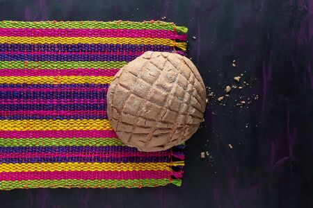 Concha Bread, Mexican Sweet Scone on Woven Tablecloth.