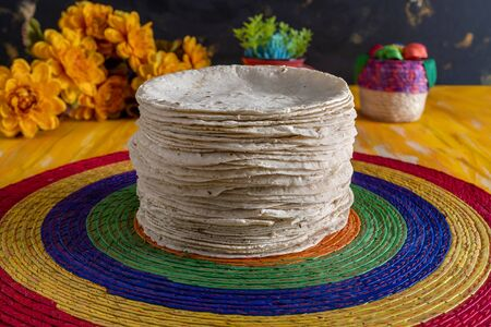 Tortillas Mexican Food on Woven Tablecloth.