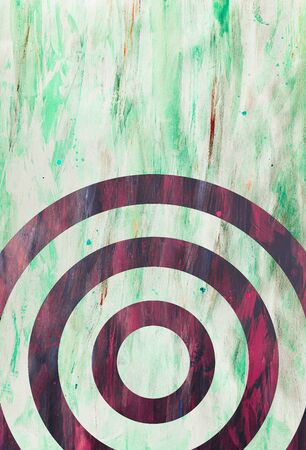 Green and Purple Paint Strokes on Canvas Surface with concentric circles.