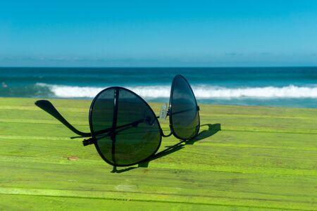 Sun glasses with Beach in the Background Archivio Fotografico - 138020622