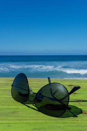 Sun glasses with Beach in the Background Archivio Fotografico - 138020481