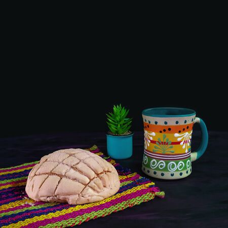 Concha Bread, Mexican Sweet Scone and Coffee Jar on Woven Tablecloth.