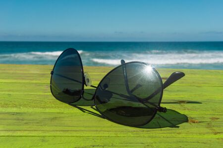 Sun glasses with Beach in the Background