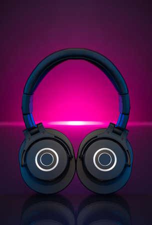 Gamer Headphones Dark Background and colorful pink Light. Stockfoto