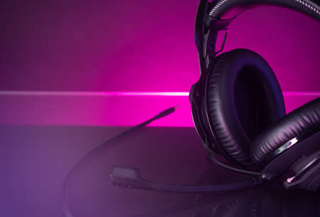 Gamer Headphones Dark Background and colorful Light.