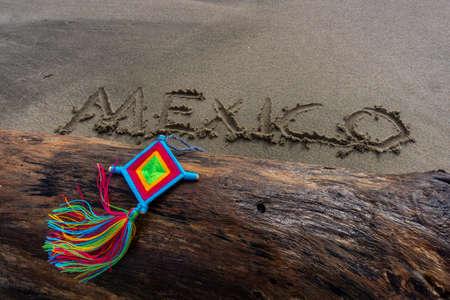 Mandala Eye of God Mexico Huichol Crafts on trunk in Sayulita beach.